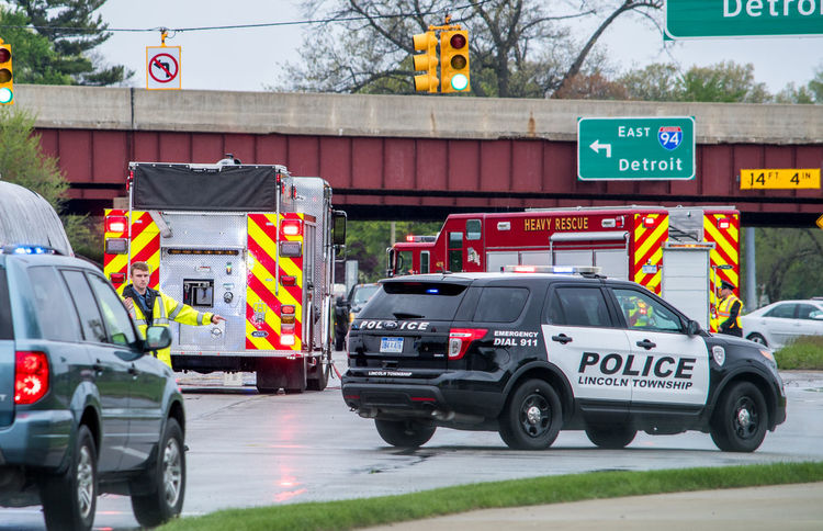 May 18 2018 Stevensville MI USA; a police officer directs traffic at the scene of a bad accident Accident On A Highway Accidents And Disasters Architecture Bad Accident Car City Communication Day Editorial  Fire Engine Fire Trucks First Responders Government Land Vehicle Motor Vehicle Outdoors Police Directing Traffic Rescue Road Sign Slippery Roads Street Transportation Truck Workers At Work