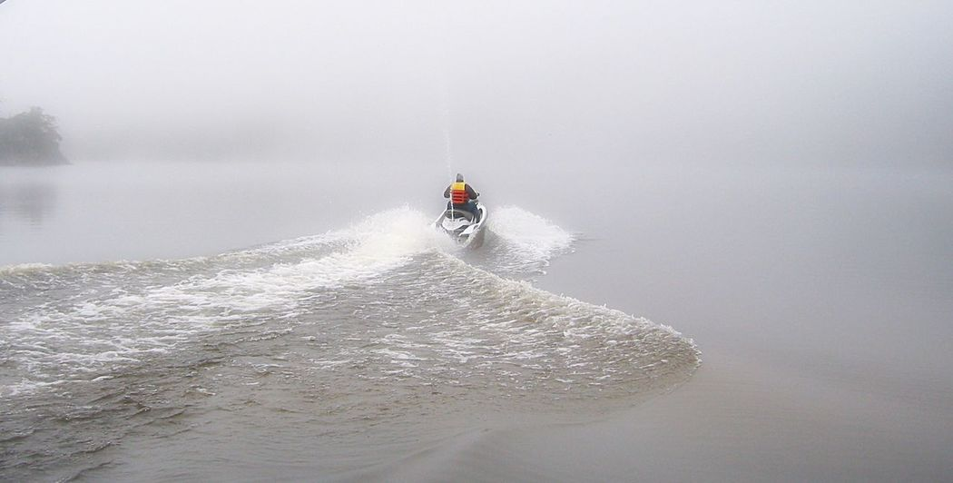 Winter scene of jetski on calm misty lake Calm Water Fog Jetski Lake Mist Misty Morning Wake Water Wintertime