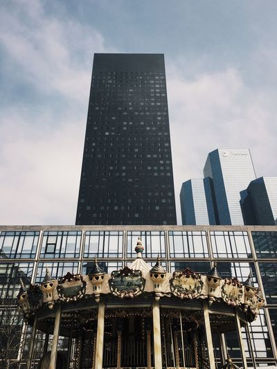 Low angle view of tall buildings against the sky