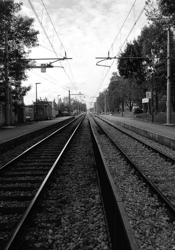 Tivoli, Ljubljana, Slovenia Slovenia Railroad Track Rail Transportation The Way Forward Sky Vanishing Point Diminishing Perspective Tree Trees Railway Track Tranquil Scene Cloud - Sky Railroad Station Outdoors Straight Day Blackandwhite Blackandwhite Photography Public Transportation Railroadphotography Monochrome Photography