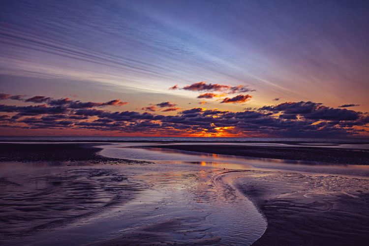 Beach Beauty In Nature Cloud - Sky Dusk Horizon Horizon Over Water Idyllic Land Nature No People Orange Color Outdoors Reflection Scenics - Nature Sea Sky Sunset Tranquil Scene Tranquility Water