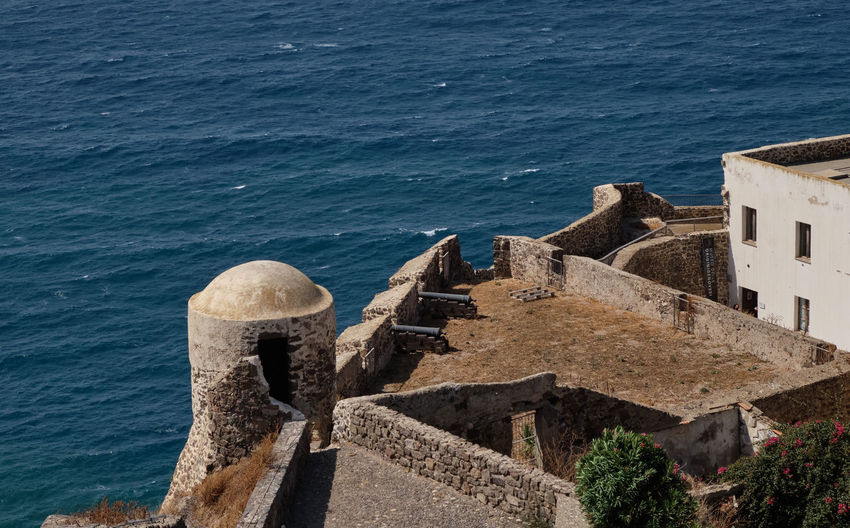 High angle view of old building by sea