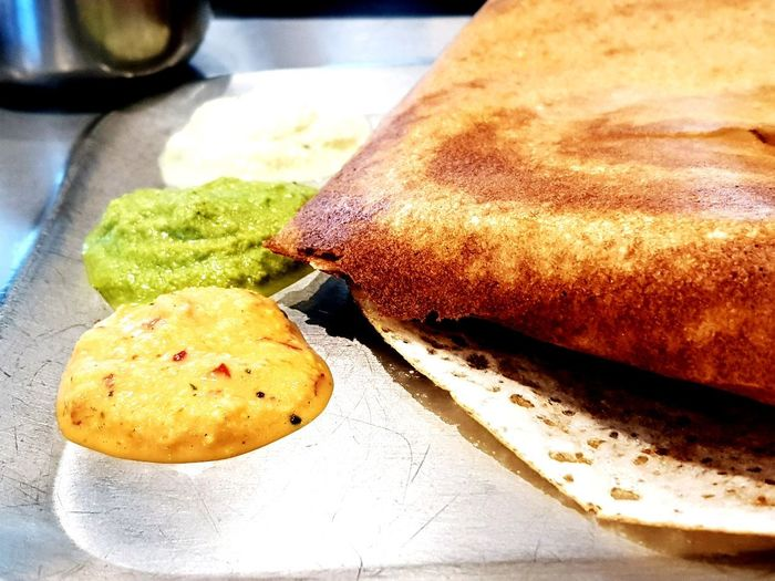 A Roasted Masala Dosa at a South Indian Restaurant. Indian Food South Indian Food Dosa Dosa Chutney Chutney Close-up Freshness Indoors  No People Healthy Eating Close-up Plate Food Stories