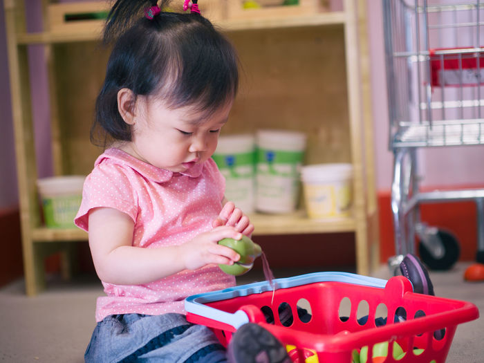 baby girl playing toy at home Basket Childhood Cute Day Focus On Foreground Girls Indoors  One Person People Real People Shopping Toy