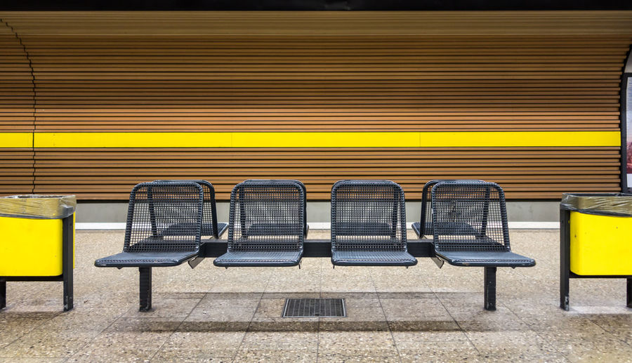 Absence Abundance Arrangement Bench Conformity Convenience Empty Group Of Objects In A Row Large Group Of Objects Lines Order Public Transport Rail Transportation Railroad Station Repetition Seat Seating Bench Sitzbank Subway Station U-Bahnhof Vibrant Color Yellow