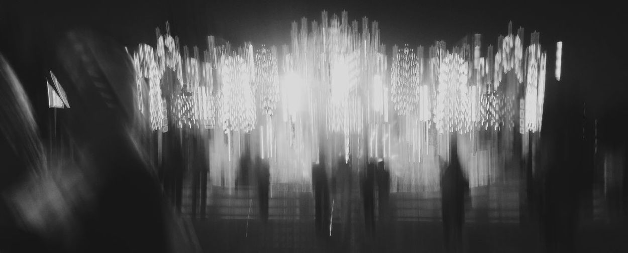 Blurred motion of illuminated lights on window at night
