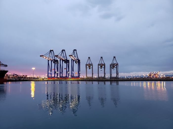 Pier over lake against sky at dusk