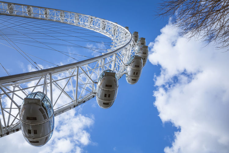 Ferris wheel cabins. Directly below. Day Natural Light Sky Low Angle View Amusement Park Amusement Park Ride Cloud - Sky Ferris Wheel Built Structure No People Leisure Activity Fairground Outdoors Summer Worm's Eye View Directly Below Cabin Geometric Shape Blue Tall - High