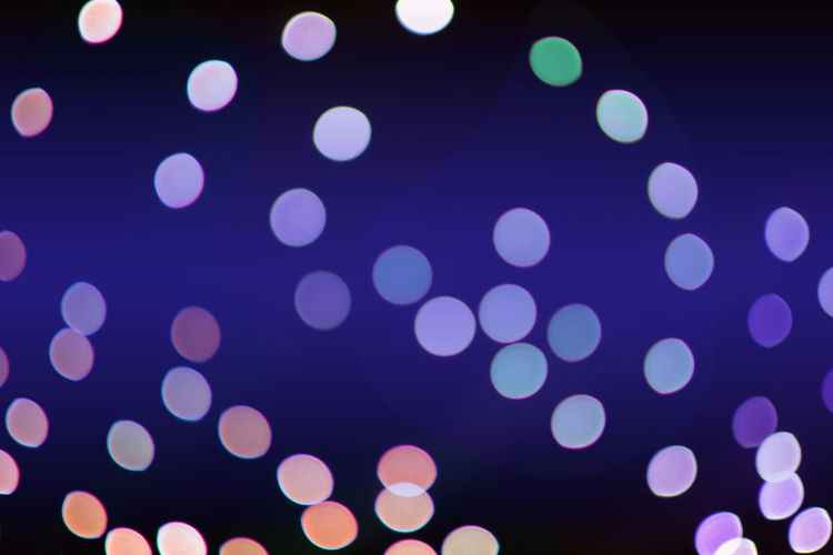 Bokeh light, defocused of light in Chirstmas Chistmas Abstract Blue Circle Defocused Glowing Light Light - Natural Phenomenon Night Nightlife No People Pattern Purple Spotted