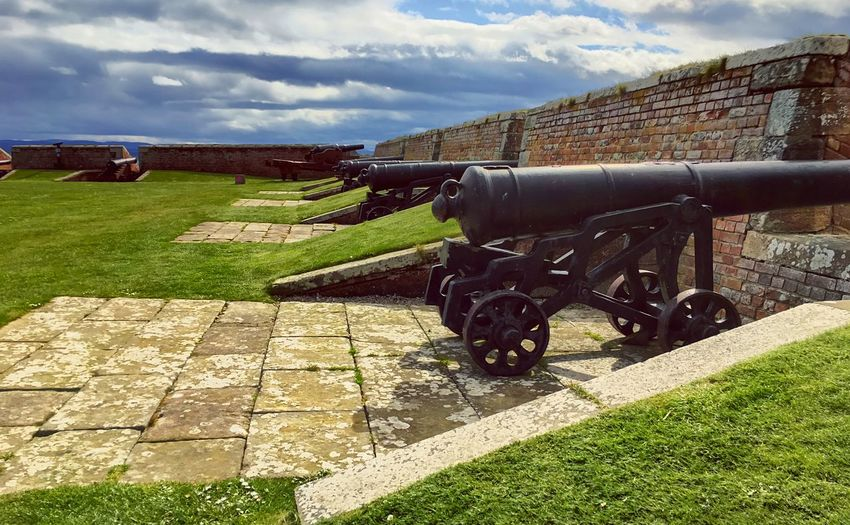 Cannons at the Fortress Fort Goerge near Inverness, in the highlands of Scotland Fort George Scotland Highlands Inverness Canon Fort Cloud - Sky Sky Nature Grass Day No People Field Sunlight Architecture Outdoors Rural Scene Land Vehicle Land Building Exterior Environment