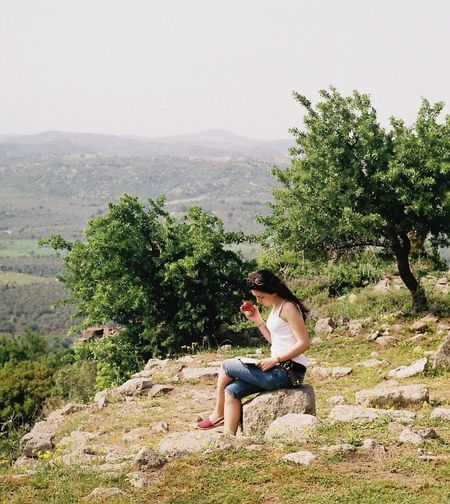 Apple Sitting Tree Casual Clothing Full Length Nature Day Women Analogue Photography Zenit122 One Person Mountain Plant Young Adult Young Women Outdoors Sky Adult People