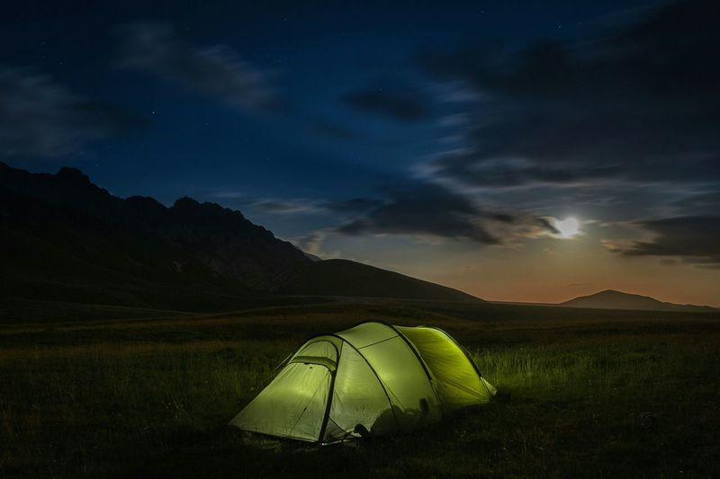 Scenic View Of Tent Under Cloudy Sky