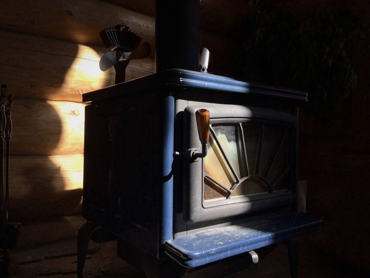 Woodstove Wood Vintage Sunrays Contrast Cabin Log Cabin Fire Place Wood Burning Stove Industrial Vintage Photography IPhoneography Blue Handle Castiron Sunlight Sunlight And Shadow Check This Out Enjoying Life Warmth Travel