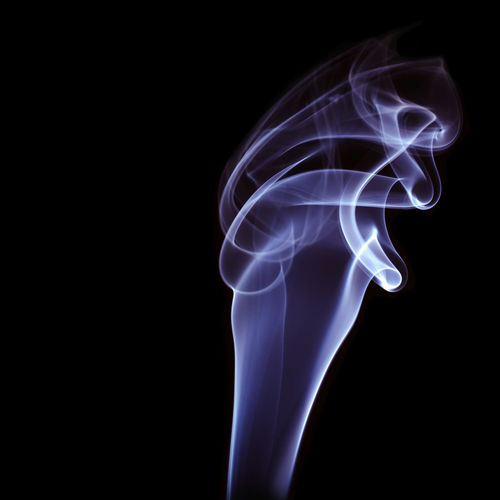 Abstract Black Background Blue Burning Changing Form Close-up Copy Space Curve Cut Out Design Illuminated Indoors  Motion No People Pattern Shape Smoke - Physical Structure Smooth Studio Shot Swirl White Color