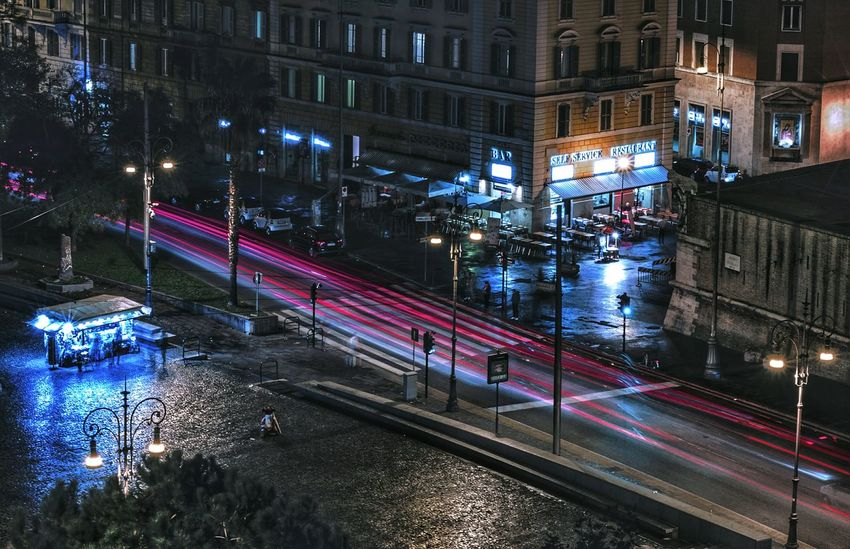 Night Illuminated Street City Light Trail Traffic City Street Street Light Building Exterior Architecture Car High Angle View City Life Transportation Road Outdoors Vehicle Light Stoplight Built Structure No People Perspectives On Nature EyeEmNewHere Moving Around Rome