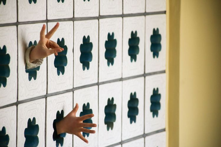 Hands coming out from window