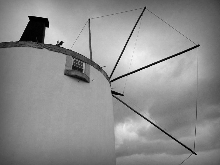 Architecture Building Built Structure Check This Out Cloud Cloud - Sky Clouds And Sky Cloudy Day Directly Below EyeEm Best Shots High Section Low Angle View Low Angle View Modern No People Outdoors Overcast Pole Sky Tall - High Tranquility Weather Vane Windmill Windmills