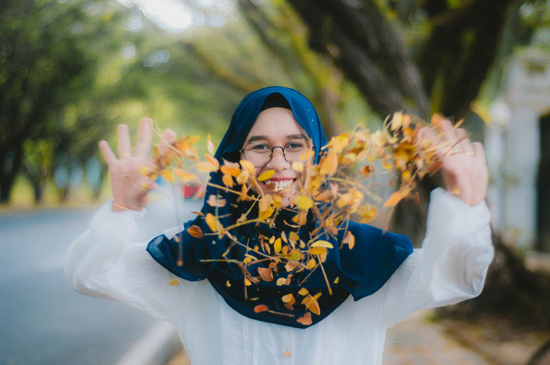 Heart shaped flower. Front View One Person Real People Portrait Lifestyles Looking At Camera Waist Up Women Holding Yellow Young Adult Focus On Foreground Plant Nature Outdoors Human Arm Gesturing Flower Muslimah Muslim Heart Hand Happiness