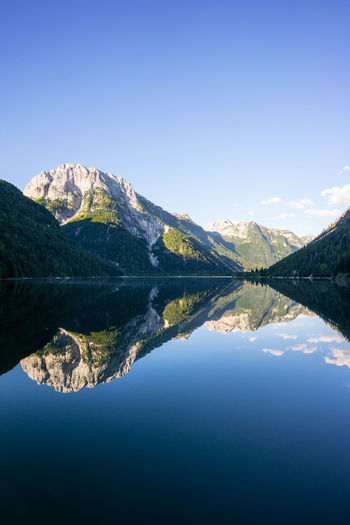 Sunrise at Lago Predil Beauty In Nature Blue Blue Sky Clear Sky Idyllic Lake Landscape Landscape_Collection Mountain Mountain Range Nature Nature No People Outdoor Photography Outdoors Reflection Reflection Reflections Scenics Sky Tranquil Scene Tranquility Tranquility Water Waterfront