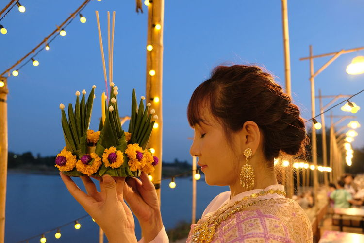 Beauty in thai style And the unique traditions. Loy Krathong Day In the countryside of Thailand. This Is Natural Beauty Loy Krathong Thai Dress Thai National Dress Thai Women Countryside Of Thailand Loy Krathong Day Unique Traditions Beauty In Thai Style Women Headshot Lifestyles Hairstyle Pray Praying Illuminated Outdoors Focus On Foreground Young Women One Person Artificial Flowers And Leaves Young Adult Emotion Believe