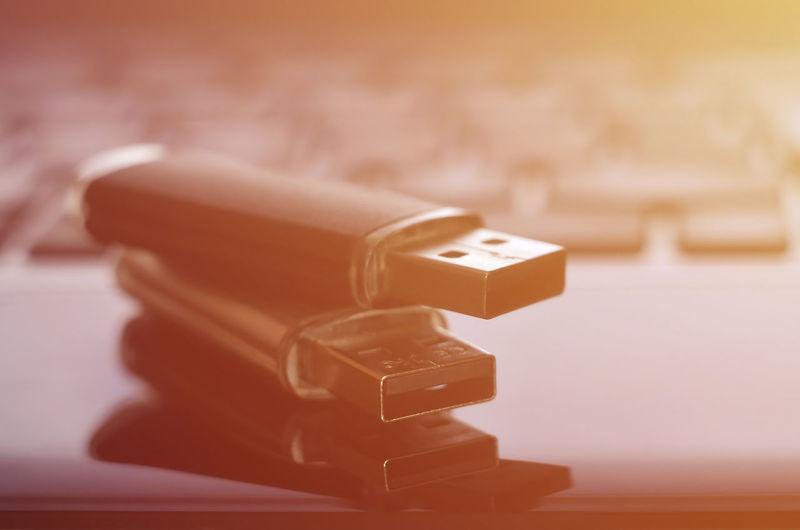 Close-up of usb stick on laptop