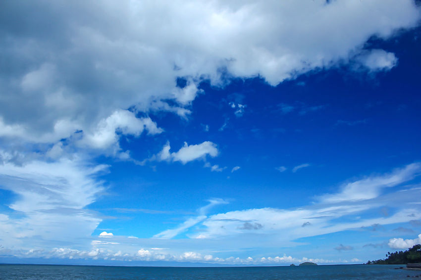 Sea View Clouds in the Sky on a Bright Day Beauty In Nature Blue Cloud - Sky Day Environment Horizon Horizon Over Water Idyllic Landscape Landscape Sea Low Angle View Nature No People Non-urban Scene Outdoors Scenics - Nature Sea Sky Tranquil Scene Tranquility Water