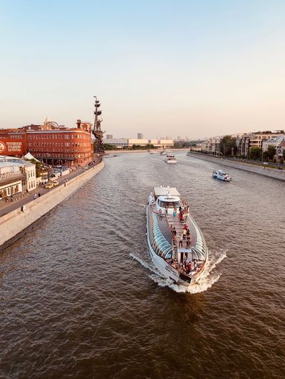 Moscow Architecture City Moscow Life City Life Moscow River Riverside River View River Building Exterior Built Structure Nautical Vessel Transportation Water Mode Of Transportation Travel Destinations Passenger Craft Cityscape Bridge - Man Made Structure Waterfront Travel Sunset The Mobile Photographer - 2019 EyeEm Awards The Traveler - 2019 EyeEm Awards