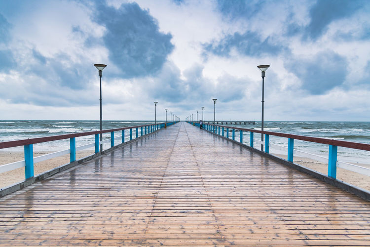 View of pier on sea against sky