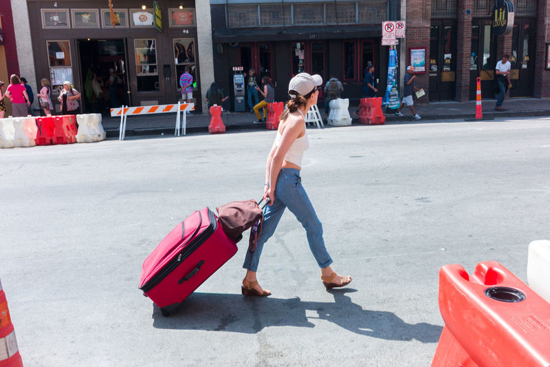 Austin Texas Casual Clothing City Life Downtown Street Suitcase SXSW Walking