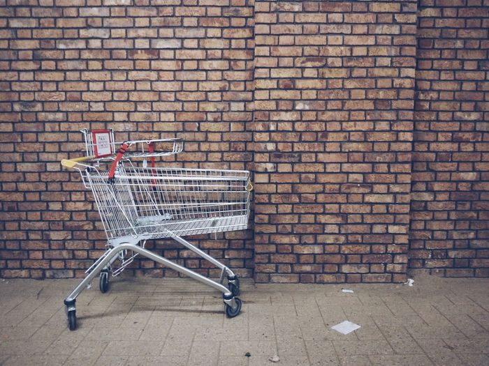 Trolley Shopping Cart Wall Brick Wall Brick Minimalism Minimal Minimalobsession VSCO Textures And Surfaces Daily Life Streetphotography Street Photography Streetphoto_color Ladyphotographerofthemonth Showcase: February Pastel Power The Graphic City