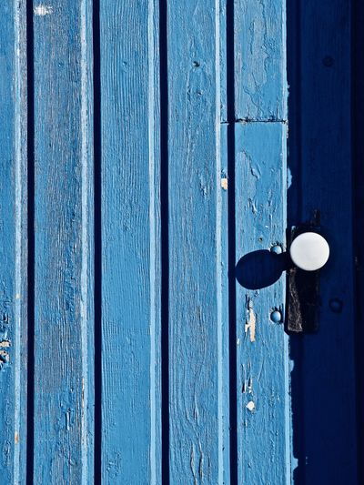 Full Frame Shot Of Blue Door On Sunny Day