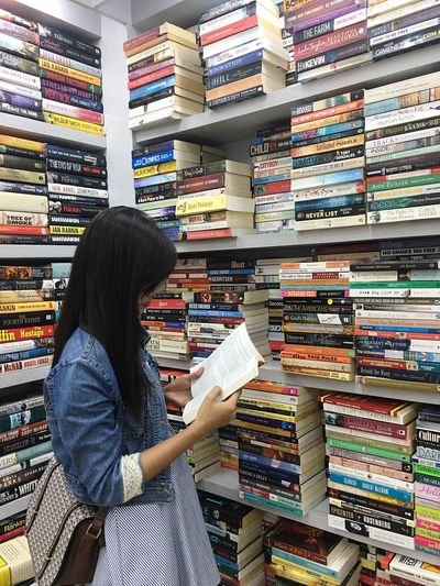 Choice Variation Large Group Of Objects Library Looking Abundance Indoors  Choosing Shelf Long Hair Side View Only Women Retail  Customer  Stack One Person People Adult Decisions Women