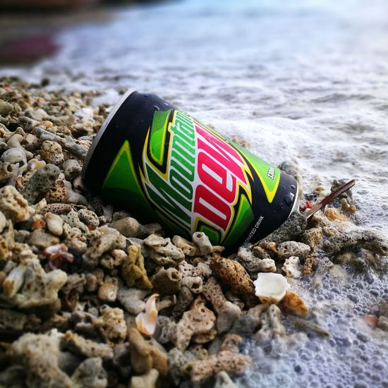 EyeEm Selects Lets do the Dew! Beach Sand Water No People Sea Multi Colored Day Outdoors Nature Close-up Mountaindew  Letadothedew Dothedew Photography Travelphotography Experience Philippines Huawei P9 Leica P9photography MAPBphotography Huaweiphotography Itsmorefuninthephilippines