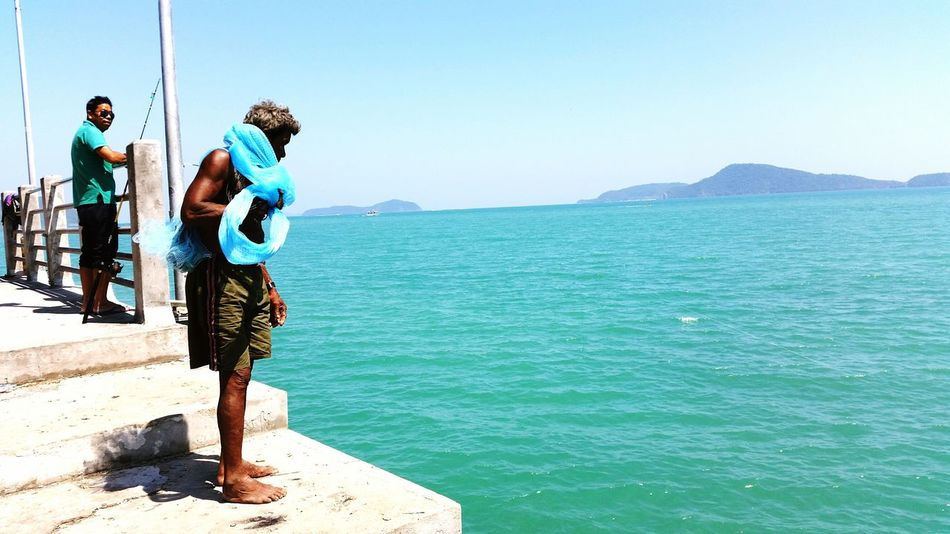 Senior fisherman looking for fish from the pier. Tropical Water Summer ASIA Thailand Travel Photography Sea Outside Photo Ocean Man Senior Day Phuket Bridge Old Still Life Thai Sport Food Job Work Fisherman Pier Travel