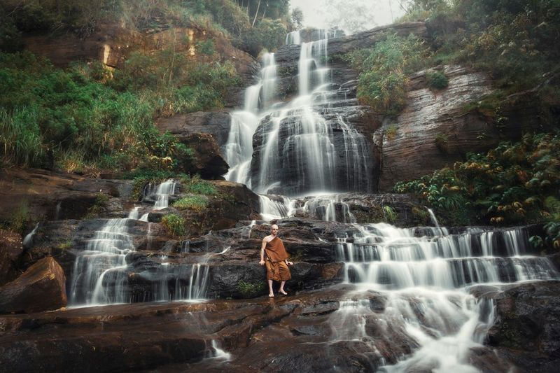 Wilderness waterfalls Waterfall Water Scenics - Nature Motion Forest Rock - Object Rock Tree Beauty In Nature Long Exposure Nature Plant Blurred Motion Solid Environment People Land Flowing Water Power In Nature Outdoors Rainforest Looking At View Flowing