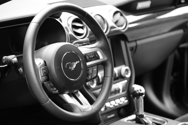 ford mustang interior Ford Mustang Ford Mustang EyeEm Selects Car Interior Car Vehicle Interior Steering Wheel Transportation Motor Vehicle Mode Of Transportation Land Vehicle Dashboard Control Panel Gearshift Close-up Control Focus On Foreground No People Vehicle Part Day Travel