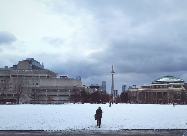 Lone walker going to class Silence Seeing The Sights Clouds And Sky Urban Photography From My Point Of View City Landscape Cityscape City Life Discover Your City People Watching Snow Fall Silhouette_collection University Life University Campus University Toronto Downtown Toronto My Student Life Snow University Of Toronto Architecture_collection CN Tower - Toronto CN TOWER Toronto Canada People And Places On The Way