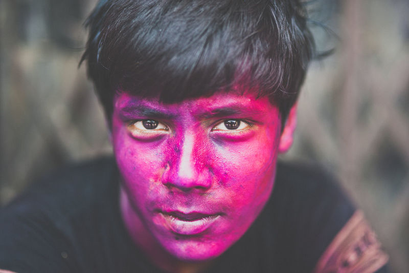 Portrait Of Man With Face Paint During Holi