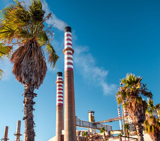 Oil Refinery in Algeciras port city. South Spain Algeciras Andalucía Blue Sky Chemical Plant Chimney Cádiz, Spain Energy Engineering Europe Fuel And Power Generation Gasoline Industry Manufacturing Nobody Oil Refinery Outdoors Palm Trees Petrochemical Plant Pipe Plant SPAIN Steam Sunny Day Toxic Vapor