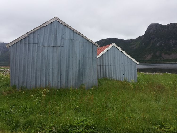Grass Relaxing Architecture Boathouse Building Exterior Built Structure Day Grass Grey Mountain Nature No People Outdoors Sky