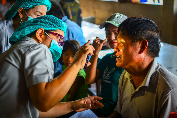 Chiang Rai, Thailand Volunteer Medical Healthcare And Medicine Public Dental Hospital Thailand Help Real People Men Clothing Group Of People Males  Boys Lifestyles Togetherness Child People Women Holding Adult Childhood Hat Females Emotion Smiling Mid Adult
