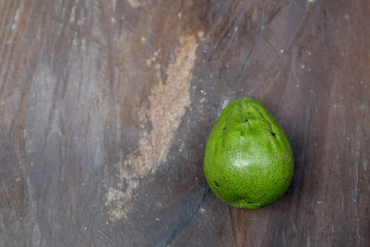 High angle view of avocado on wooden table