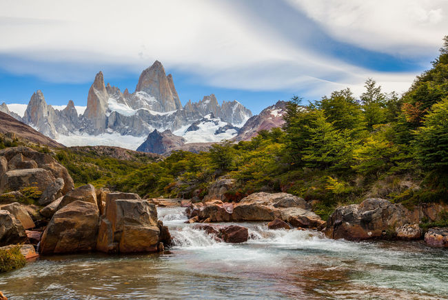 Cerro Fitz Roy with Rio Fitz Roy Argentina Beauty In Nature Chile Day Fitz Roy Fitz Roy Mountain Glacial Height Landscape Mountain Nature No People Outdoors Range Scenery Sky Torres Del Paine Wallpaper Water Wilderness