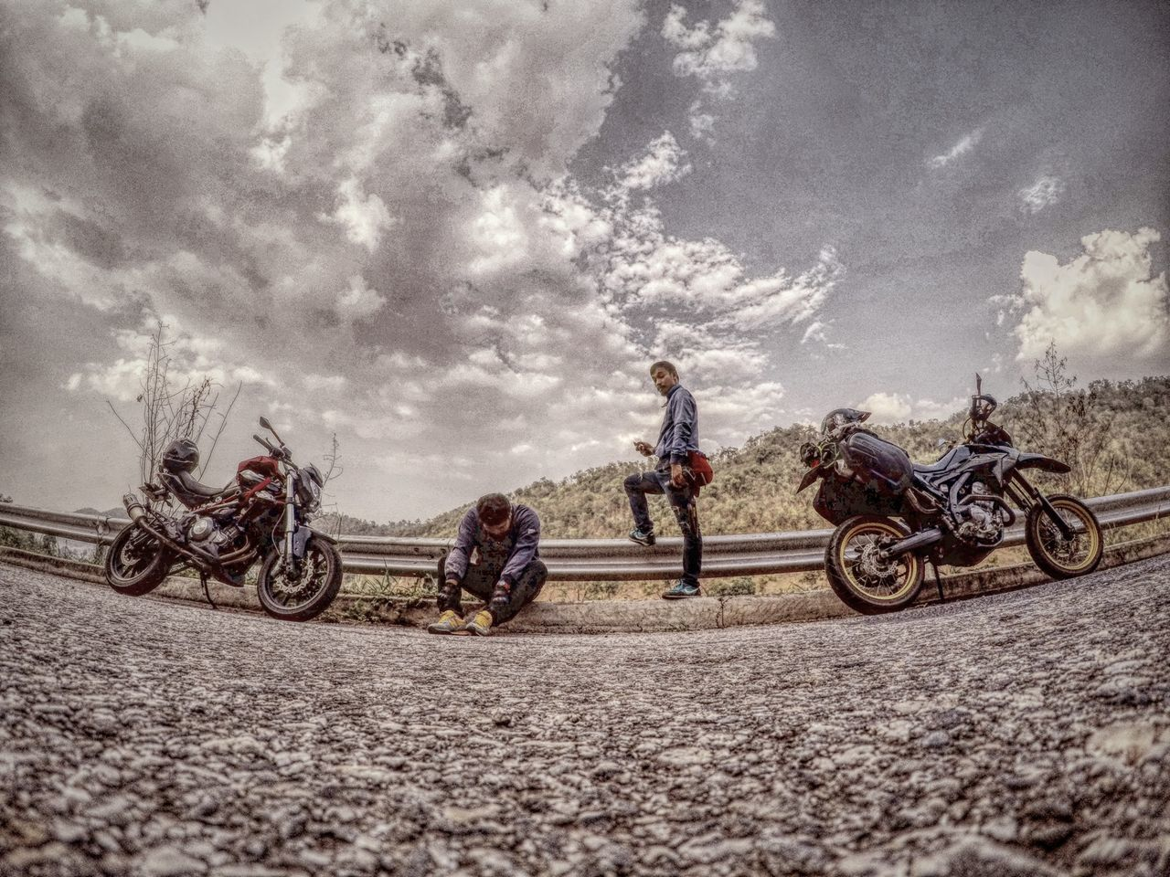 transportation, land vehicle, motorcycle, cloud - sky, men, riding, real people, mode of transport, day, sky, outdoors, adventure, road, helmet, motorsport, togetherness, sitting, motocross, sports race, extreme sports, biker, adult, people