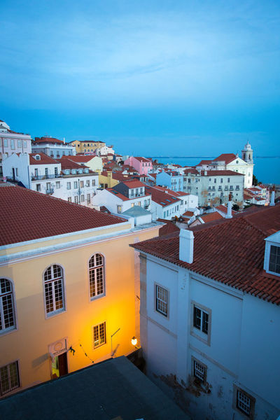 Architecture Blue Blue Hour Blue Hour Cityscape Blue Sky Building Exterior Built Structure City Cityscape Colorful Evening Evening Sky High Angle View Lisbon No People Old City Old Town Orange Light Outdoors Portugal Positive Residential Building Roof Sky