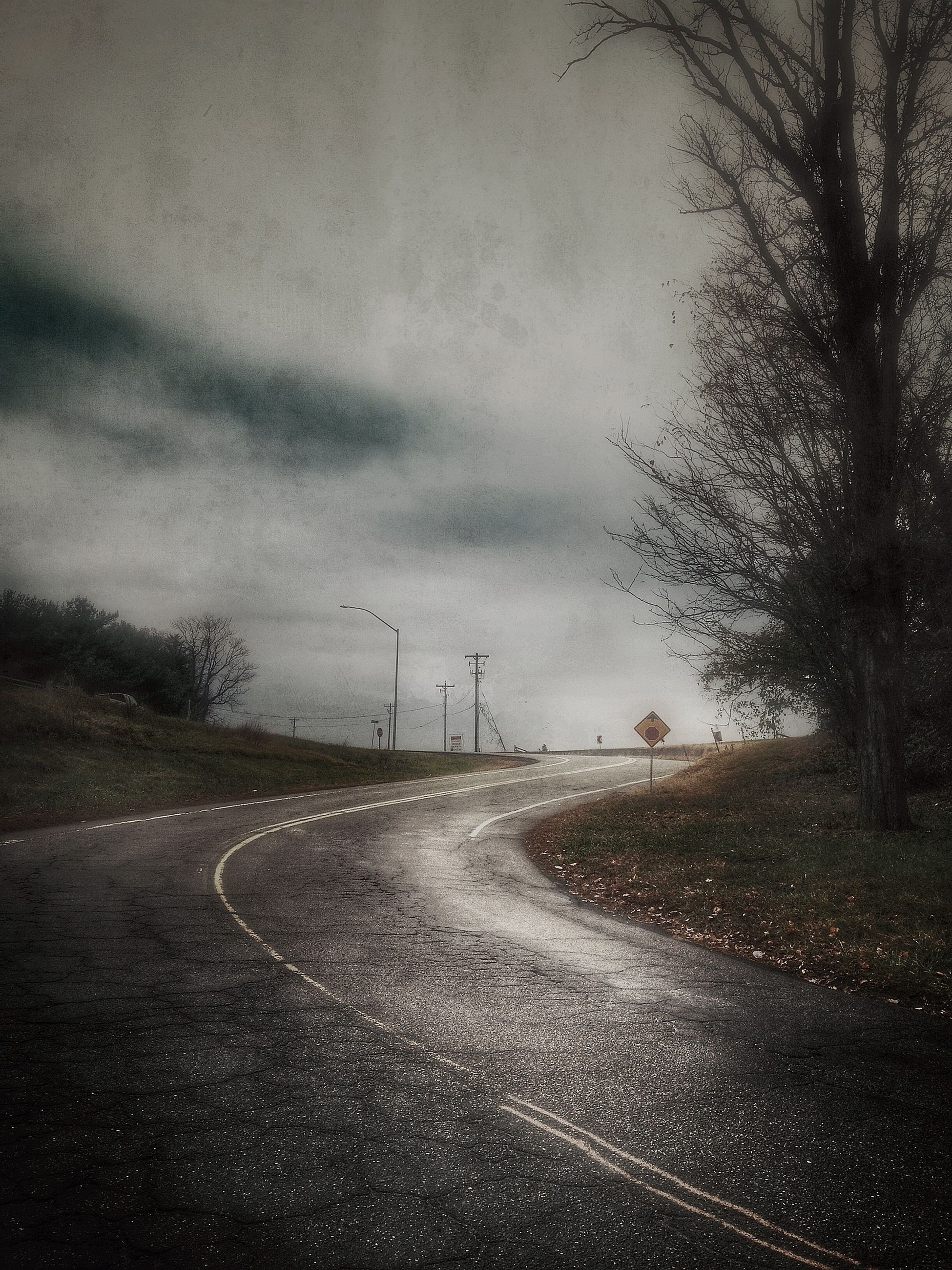 the way forward, road, transportation, road marking, sky, diminishing perspective, vanishing point, country road, empty road, cloud - sky, street, asphalt, cloudy, tree, empty, landscape, nature, tranquility, overcast, weather
