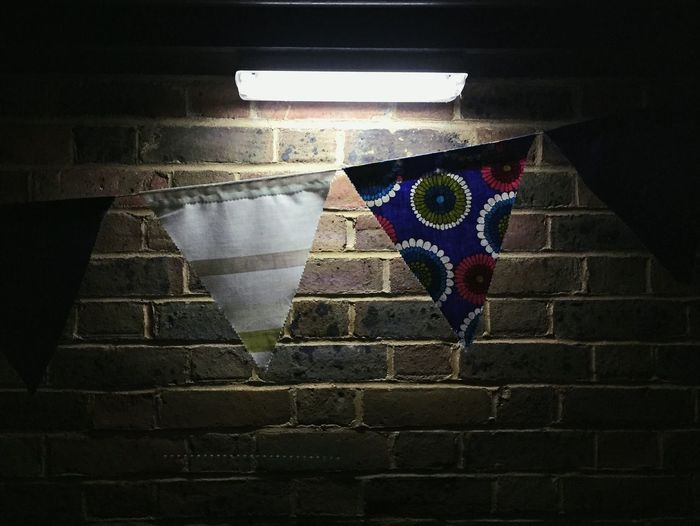 Bunting After Dark Nighttime Lights Brick Wall Brick Brickwork  Flags Fabric Pattern Pattern, Texture, Shape And Form