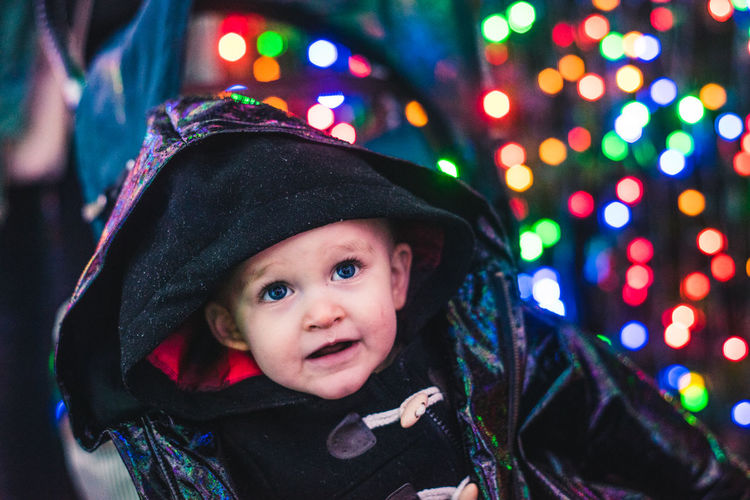 Christmas Lights Cheerful Childhood Close-up Cute Happiness Indoors  Lifestyles Looking At Camera Night One Person People Portrait Rainy Real People Smiling Toddler  Warm Clothing