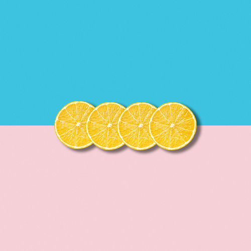 Directly above shot of lemon slices on colored background