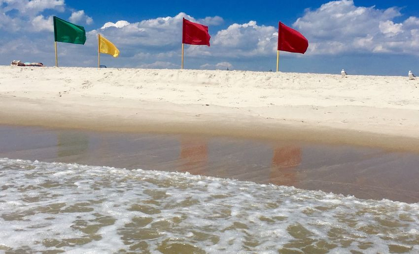 Sand Reflection Ocean Summertime 🌞 Beach Time EyeEm Selects Beach Water Land Flag Sea Sand Nature Day Sky Beauty In Nature EyeEmNewHere